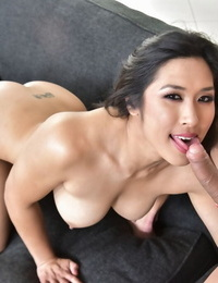 Top Asian pornstar Mia Li deep throats the man chowder out of an uncut shaft
