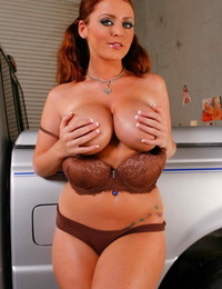 Appetizing redhead with blue eyes Sophie Dee strips uniform in the garage