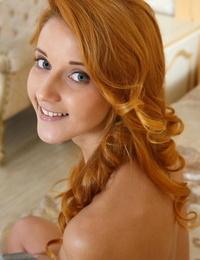 Redhead glamour honey Roberta Berti spreading shaven teen pussy