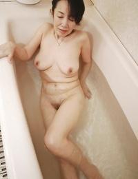 Tsuyako Miyataka getting all wet while taking a much needed tub