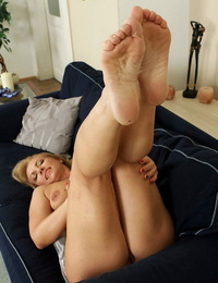 Whorish mature wifey sheds white lingerie to squat nude baring smooth-shaven pussy