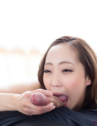 Japanese woman runs her tongue over a dick until it ejaculates