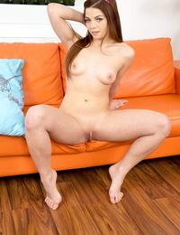 Teen solo woman Loreen undresses for fingering of taut beaver on chesterfield
