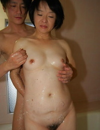 Mature Oriental Tomoe Nakamachi has boobs fondled and deepthroats shaft