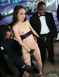 Young puny caked teenage Amai Liu gets surrounded by big captured cocks