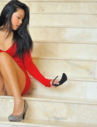 Cute Asian solo chick hikes her red sundress to expose her trimmed beaver