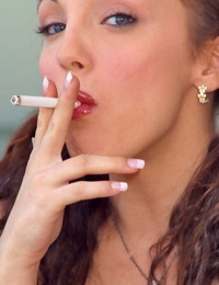 Glamour model takes off all her clothes while smoking a cigarette