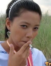 Youthful Filipino schoolgirl fucks a hookup tourist in interchange for a cigarette