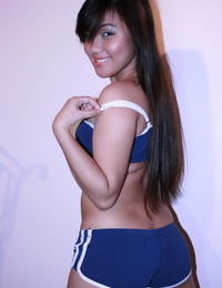 Sporty Asian teenage gives a loosened striptease to hang out nude