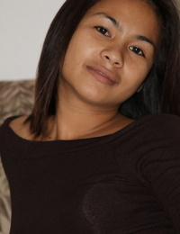 Wonderful Filipina honey rubbing her killer nipples and Asian pussy in sofa
