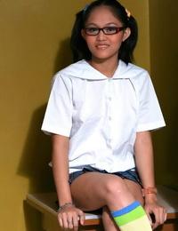 Slurps Asian teenage slips off her upskirt lingerie in multi-colored knee socks