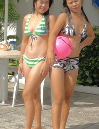 Thai bombshells in stellar swimsuits Nicole and Anne having joy at the pool