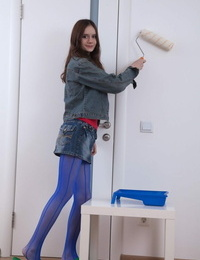 Thin teen Lolita uncovers her hairy beaver and small breasts on the floor
