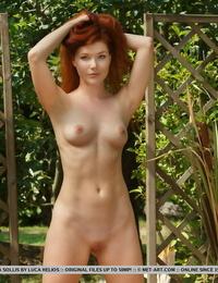 Congenital redhead Mia Sollis takes off nude on a blanket in backyard