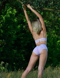 Youthfull light-haired touts her adorable nut as she eliminates lingerie in shade of a tree