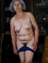 Saggy jugged granny Nina takes her clothes off and toys her unshaved pussy