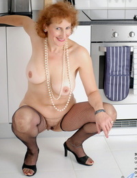 Big-titted mature whore Naomi Xxx plays with her pussy on the kitchen floor