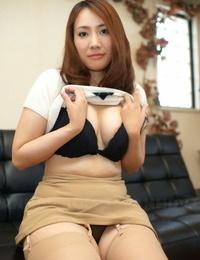 Japanese redhead Akari Niiyama gushes her shaven cunt in sheer nylons
