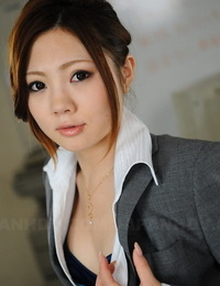 Gorgeous Japanese businesswoman Iroha Kawashima exposes her hooter-sling at work