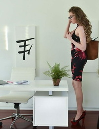 Glasses dressed Russian stunner Elena Koshka poses erotically in sheer underwear