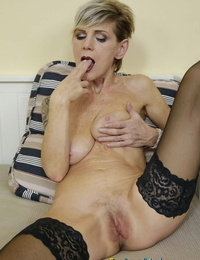 Granny Iva B shows off her mature assets and fucktoys her wild pics